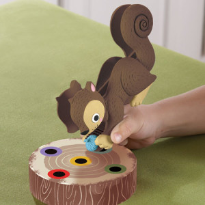Learners must use the Squirrel Squeezer to grasp the acorn and place it on the log. I love this unique aspect of the game for working on motor skills in a fun way!