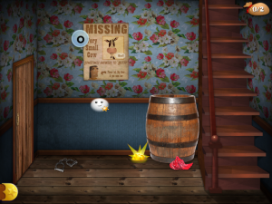 "The game requires scanning for multiple items. In this room, the player must scan to find the letter ""o,"" the piece of missing gold next to the barrel, and entrances to other rooms in the building."